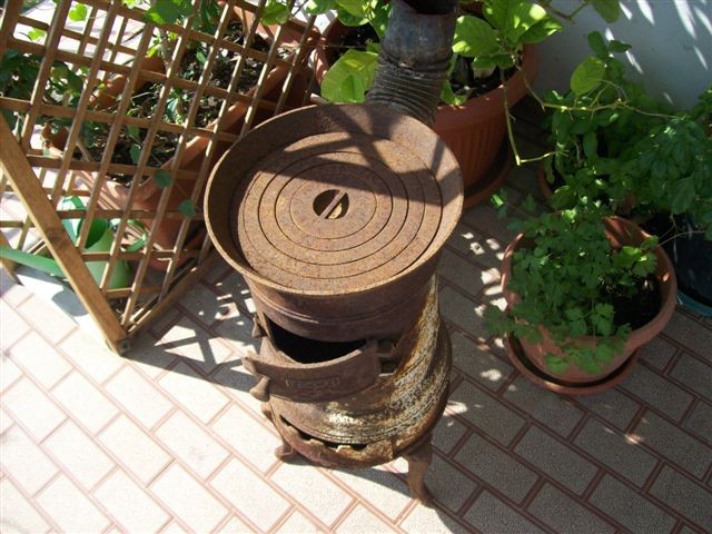 Restauro stufa for Vecchia stufa a legna in ghisa